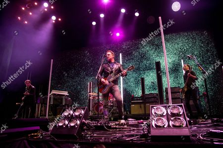 Stock Photo of Dean Fertita, Josh Homme, Michael Shuman. Dean Fertita, from left, Josh Homme and Michael Shuman of Queens of the Stone Age perform at the 2017 KROQ Almost Acoustic Christmas at The Forum, in Inglewood, Calif