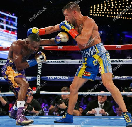 Vasyl Lomachenko, Guillermo Rigondeaux. Vasyl Lomachenko, right, of Ukraine, tries to hit Guillermo Rigondeaux with a right during the sixth round of a WBO junior lightweight title boxing match, in New York. Lomachenko won the bout