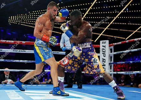 Vasyl Lomachenko, Guillermo Rigondeaux. Vasyl Lomachenko, left, of Ukraine, punches Guillermo Rigondeaux during the sixth round of a WBO junior lightweight title boxing match, in New York. Lomachenko won the bout