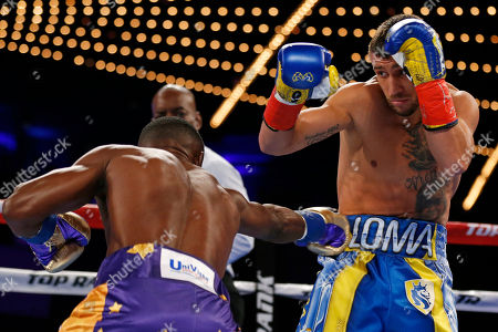 Vasyl Lomachenko, Guillermo Rigondeaux. Vasyl Lomachenko, of Ukraine, avoids a punch by Guillermo Rigondeaux during the first round of a WBO junior lightweight title boxing match, in New York