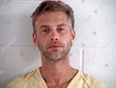 Provided by the Ashland County Sheriff Office shows Shawn M. Grate, arrested, in Ashland, Ohio. Investigators trying to identify the alleged first victim of the Ohio man suspected in four killings say they've received 10 to 15 tips in the month since Grate described killing a magazine seller in her mid-20s around 2005 in Marion County, Ohio, but authorities still don't have a name for the body found in 2007