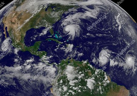 Stock Photo of This image made available by the NOAA-NASA GOES Project shows tropical weather systems Hurricane Norma, left, on the Pacific Ocean side of Mexico; Jose, center, east of Florida; Tropical Depression 15, second from right, north of South America, and Tropical Storm Lee, right, north of eastern Brazil, on at 2:45 p.m. EDT