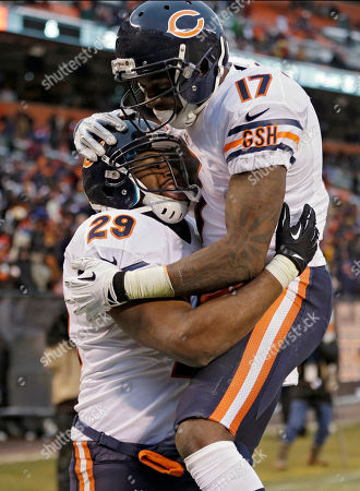 Chicago Bears running back Michael Bush (29) celebrates with wide receiver Alshon Jeffery (17) after Bush ran 40 yards for a touchdown against the Cleveland Browns in the fourth quarter of an NFL football game, in Cleveland. The Bears won 38-31