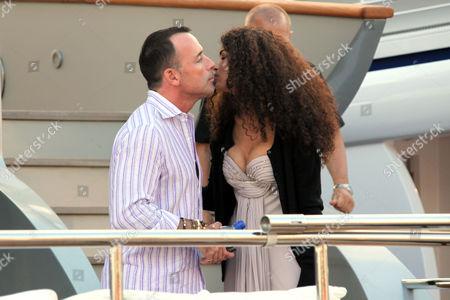 David Furnish visiting his friend Afef Jnifen on board of Roberto Cavalli's boat