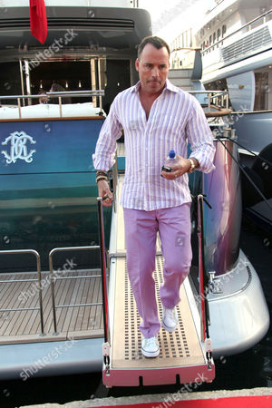 David Furnish on board of Roberto Cavalli's boat