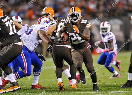 Cleveland Browns running back Willis McGahee (26) runs for a first down against the Buffalo Bills in the second quarter of an NFL football game, in Cleveland