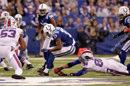 T.Y. Hilton, Ruvell Martin, Brad Smith, Nigel Bradham. Indianapolis Colts wide receiver T.Y. Hilton, left, is chased by Buffalo Bills' Ruvell Martin, right, and Brad Smith before being hit by Bills linebacker Nigel Bradham as he returns a punt during the first half of an NFL football game in Indianapolis, . Hilton was injured on the play
