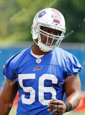 Stock Photo of Buffalo Bills linebacker Keith Rivers (56) takes part in drills during an NFL football minicamp in Orchard Park, N.Y