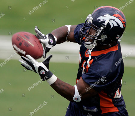 Denver Broncos running back Andre Hall pulls in a pass during football team camp, in Denver