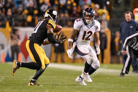 Andre Caldwell, Robert Golden. Pittsburgh Steelers strong safety Robert Golden (21) defends a pass to Denver Broncos wide receiver Andre Caldwell (12) in the first half of an NFL football game, in Pittsburgh. The Steelers won 34-27