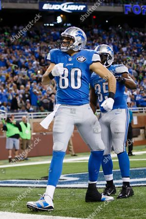 Detroit Lions tight end Joseph Fauria (80) celebrates a touchdown against the Tampa Bay Buccaneers during an NFL football game at Ford Field in Detroit