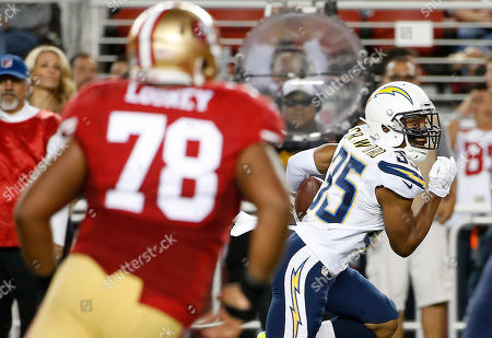 Stock Image of San Diego Chargers cornerback Richard Crawford (35) returns an interception 29 yards for a touchdown against the San Francisco 49ers during the first half of an NFL preseason football game in Santa Clara, Calif