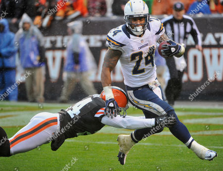 Ryan Matthews, Sheldon Brown. San Diego Chargers running back Ryan Mathews (24) runs through the tackle of Cleveland Browns defender Sheldon Brown (24) during an NFL football game in Cleveland