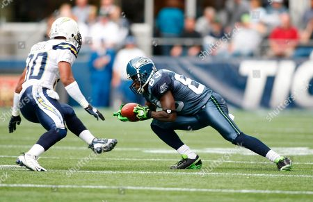 Deion Branch, Donald Strickland. Seattle Seahawks Deion Branch catches a pass with San Diego Chargers' Donald Strickland defending in the first half of an NFL football game, in Seattle