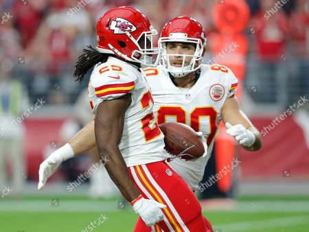 Jamaal Charles, Anthony Fasano. Kansas City Chiefs running back Jamaal Charles celebrates his touchdown with Anthony Fasano during the first half of an NFL football game, in Glendale, Ariz