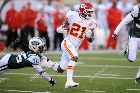 Kansas City Chiefs' Javier Arenas catches the ball under coverage by New York Jets' Isaiah Trufant during the first quarter of their NFL football game, in East Rutherford, N.J