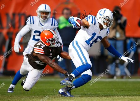 Josh Cribbs, Johnson Bademosi. Indianapolis Colts wide receiver Josh Cribbs (16) returns a kick against the Cleveland Browns cornerback Johnson Bademosi (24) during an NFL football game, in Cleveland. The Colts won 25-24