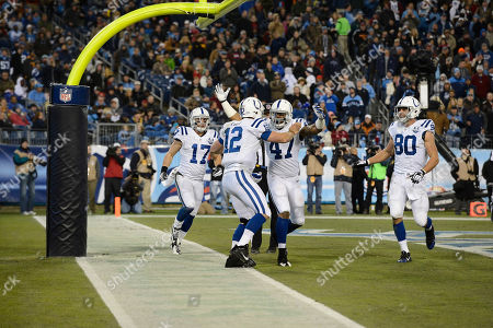 Stock Picture of Andrew Luck, Weslye Saunders, Griff Whalen. Indianapolis Colts quarterback Andrew Luck (12) celebrates with Weslye Saunders (47) and Griff Whalen (17) after Luck scored a touchdown on an 11-yard run against the Tennessee Titans in the third quarter of an NFL football game, in Nashville, Tenn