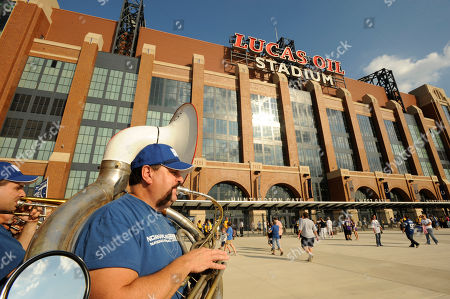 "Chris McMillan, Indianapolis, plays sousaphone with the ""12th Man Brass Band"" outside Lucas Oil Stadium before a preseason NFL football game between the Minnesota Vikings and the Indianapolis Colts in Indianapolis"