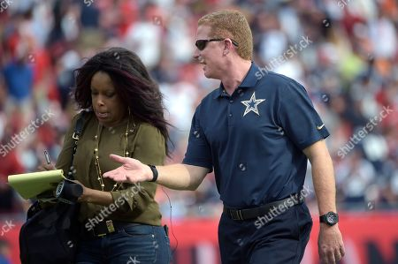 Pam Oliver, Jason Garrett. Dallas Cowboys head coach Jason Garrett, right, talks with Fox Sports sideline reporter Pam Oliver after the first half of an NFL football game against the Tampa Bay Buccaneers in Tampa, Fla