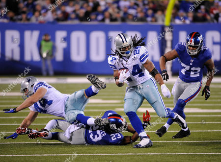 Marion Barber, Chris Gronkowski, Corey Webster, Osi Umenyiora. Dallas Cowboys running back Marion Barber (24) breaks through a hole as Giants' Osi Umenyiora (72) pursues and Cowboys' Chris Gronkowski (44) goes over Giants' Corey Webster during the third quarter of an NFL football game between the New York Giants and the Dallas Cowboys at New Meadowlands Stadium, in East Rutherford, N.J