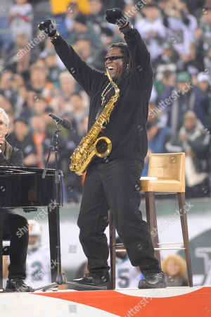 Clarence Clemons reacts after performing the national anthem before an NFL football game between the Miami Dolphins and the New York Jets at New Meadowlands Stadium, in East Rutherford, N.J