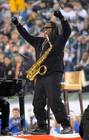 Clarence Clemons reacts after performing the national anthem at an NFL football game between the Miami Dolphins and the New York Jets at New Meadowlands Stadium, in East Rutherford, N.J