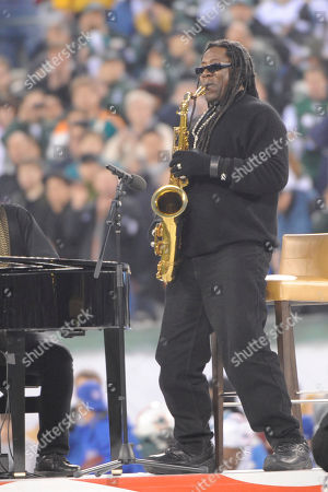 Clarence Clemons performs the national anthem before an NFL football game between the Miami Dolphins and the New York Jets at New Meadowlands Stadium, in East Rutherford, N.J