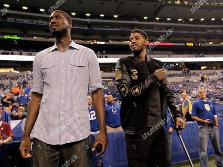 Paul George, Roy Hibbert. Indiana Pacers' Roy Hibbert, left, and Paul George visit the sideline before the start of an NFL football game between the Indianapolis Colts and the Philadelphia Eagles, in Indianapolis