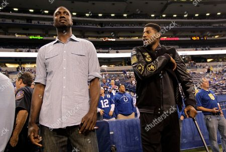 Stock Photo of Paul George, Roy Hibbert. Indiana Pacers' Roy Hibbert, left, and Paul George visit the sideline before the start of an NFL football game between the Indianapolis Colts and the Philadelphia Eagles, in Indianapolis