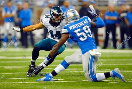 Riley Cooper, Tahir Whitehead. Philadelphia Eagles wide receiver Riley Cooper (14) makes Detroit Lions middle linebacker Tahir Whitehead (59) miss after a catch during an NFL football game, in Detroit. The Lions won the game 45-14