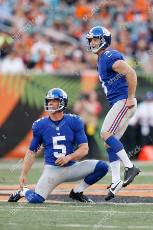 Steve Weatherford, Josh Brown. New York Giants kicker Josh Brown (3) reacts after missing a field goal from the hold of punter Steve Weatherford (5) against the Cincinnati Bengals in the first half of an NFL preseason football game in Cincinnati