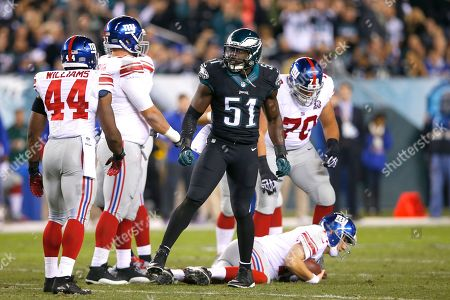 Emmanuel Acho, Eli Manning. Philadelphia Eagles inside linebacker Emmanuel Acho (51) celebrates after making a hit on New York Giants quarterback Eli Manning, bottom, during the first half of an NFL football game, in Philadelphia