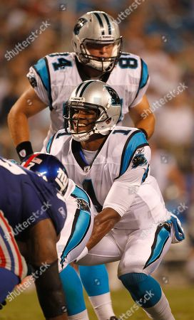 Cam Newton, Ben Hartsock. Carolina Panthers quarterback Cam Newton (1) calls the signals as teammate Ben Hartsock (84) moves into position during an NFL football game in Charlotte, N.C., . The Carolina Panthers beat the New York Giants 20-10