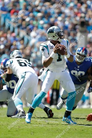 Cam Newton, Jordan Gross, Jason Pierre-Paul, Cullen Jenkins. Carolina Panthers' Cam Newton (1) stands in the pocket looking for an open receiver as his teammate Jordan Gross (69) keeps New York Giants' Jason Pierre-Paul (90) blocked and New York Giants' Cullen Jenkins (99) tries to make a play during the first half of an NFL football game in Charlotte, N.C., . The Panthers won 38-0