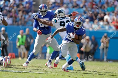 David Wilson, Will Beatty, Star Lotulelei. New York Giants' David Wilson (22) finds some running room as teammate Will Beatty (65) continues to block the Carolina panthers' Star Lotulelei (98) during the second half of an NFL football game in Charlotte, N.C., . The Panthers won 38-0