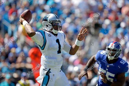Cam Newton, Keith Rivers. Carolina Panthers' Cam Newton (1) gets a pass off before New York Giants' Keith Rivers (55) can disrupt during the first half of an NFL football game in Charlotte, N.C., . The Panthers won 38-0