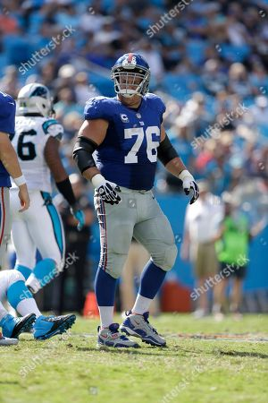 Stock Photo of New York Giants' Chris Snee (76) against the Carolina Panthers during the second half of an NFL football game in Charlotte, N.C., . The Panthers won 38-0
