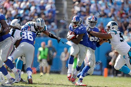 David Wilson, Greg Hardy, Bear Pascoe, Will Beatty, Star Lotulelei. New York Giants' David Wilson (22) slips through a hole in the line as Carolina Panthers' Greg Hardy (76) gets blocked out of the play by New York Giants' Bear Pascoe (86) and New York's Will Beatty (65) keeps Carolina Panthers' Star Lotulelei (98) blocked during the second half of an NFL football game in Charlotte, N.C., . The Panthers won 38-0