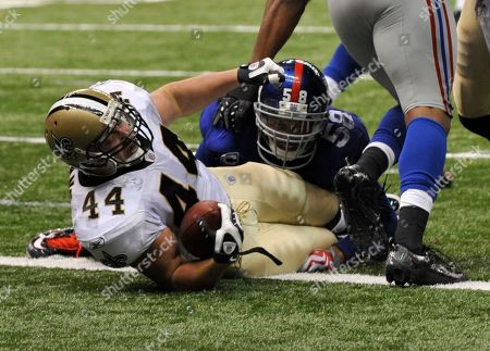 Heath Evans, Antonio Pierce. New Orleans Saints FB Heath Evans (44) scores a touchdown as New York Giants linebacker Antonio Pierce (58) defends in the second half of an NFL game between the New York Giants and New Orleans Saints in the Louisiana Superdome in New Orleans, . Saints won 48-27