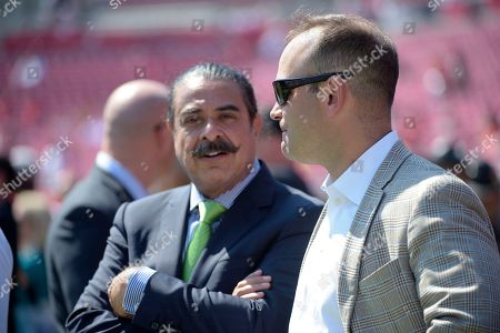 Shahid Khan, David Caldwell. Jacksonville Jaguars owner Shahid Khan watches warmups with general manager David Caldwell, right, before an NFL football game against the Tampa Bay Buccaneers in Tampa, Fla