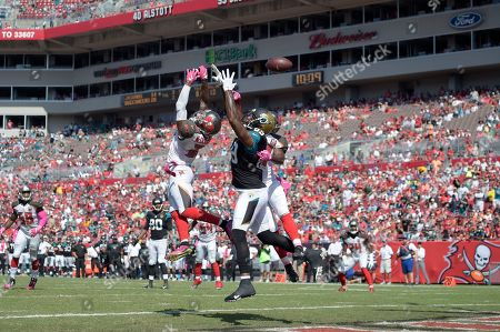 Marcedes Lewis, Bradley McDougald, Major Wright. Jacksonville Jaguars tight end Marcedes Lewis (89) has a pass deflected away by Tampa Bay Buccaneers free safety Bradley McDougald (30), left, and strong safety Major Wright (31) during the second half of an NFL football game in Tampa, Fla., . The Buccaneers won 38-31