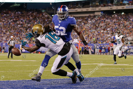 Stock Picture of New York Giants middle linebacker Jon Beason (52) breaks up a pass to Jacksonville Jaguars' Denard Robinson (16) in the end zone during the first half of a preseason NFL football game, in East Rutherford, N.J