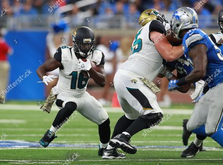 Jacksonville Jaguars running back Denard Robinson (16) runs with the ball against the Detroit Lions during an NFL football game in Detroit
