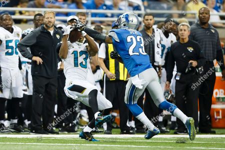 Kerry Taylor, Darius Slay. Jacksonville Jaguars wide receiver Kerry Taylor (13) makes a catch over Detroit Lions cornerback Darius Slay (23) during a preseason NFL football game at Ford Field in Detroit
