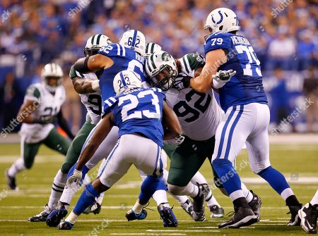 Stock Photo of Khaled Holmes, Todd Herremans, Leonard Williams, Frank Gore. New York Jets defensive end Leonard Williams (92) is blocked by Indianapolis Colts center Khaled Holmes (62) and guard Todd Herremans (79) as running back Frank Gore (23) tries to get through during an NFL football game in Indianapolis