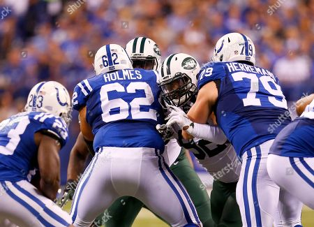 Khaled Holmes, Todd Herremans, Leonard Williams. New York Jets defensive end Leonard Williams (92) is blocked by Indianapolis Colts center Khaled Holmes (62) and guard Todd Herremans (79) during an NFL football game in Indianapolis