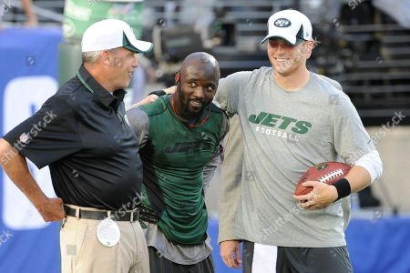 Stock Photo of Santonio Holmes, Greg McElroy, Rex Ryan. New York Jets wide receiver Santonio Holmes, center, Greg McElroy, right, and New York Jets head coach Rex Ryan, left, gather before a preseason NFL football game against the New York Giants, in East Rutherford
