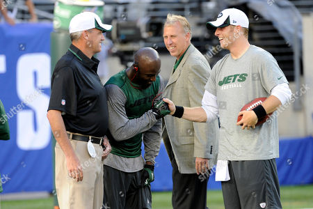 Rex Ryan, John Idzik, Santonio Holmes, Greg McElroy. New York Jets coach Rex Ryan, left, and general manager John Idzik look on as quarterback Greg McElroy, right, reacts with wide receiver Santonio Holmes before an NFL football game against the New York Giants, in East Rutherford