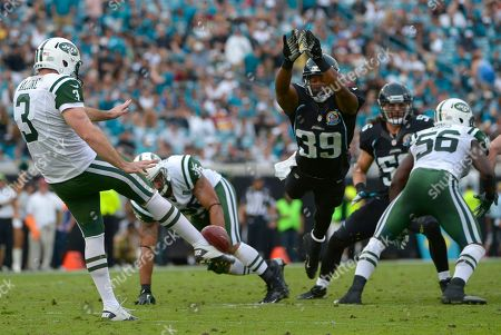 Richard Murphy, Robert Malone. Jacksonville Jaguars' Richard Murphy (39) lays his body out to attempt to block a punt by New York Jets punter Robert Malone (3) during the second half of an NFL football game in Jacksonville, Fla